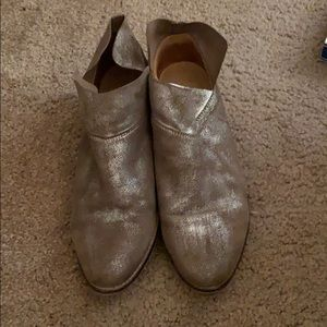 Brown and silver booties